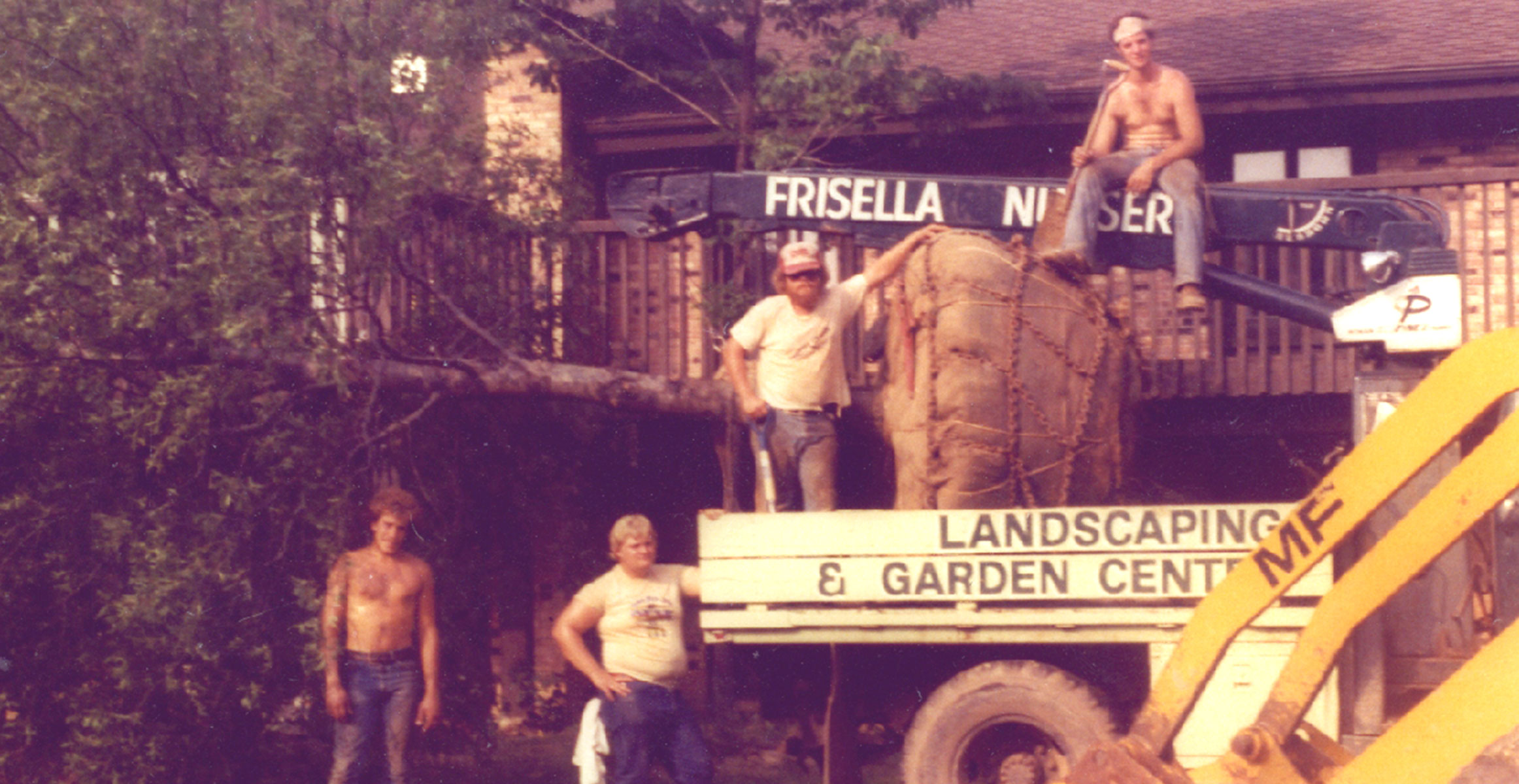 Photo of a vintage truck and Frisella employees hanging out
