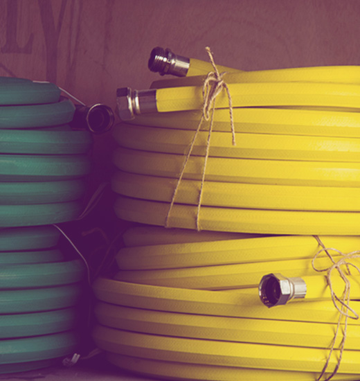 Photo of green and yellow water hoses