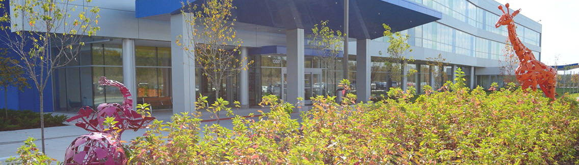 Photo of Children's Specialty Care building with landscaping by Frisella Nursery